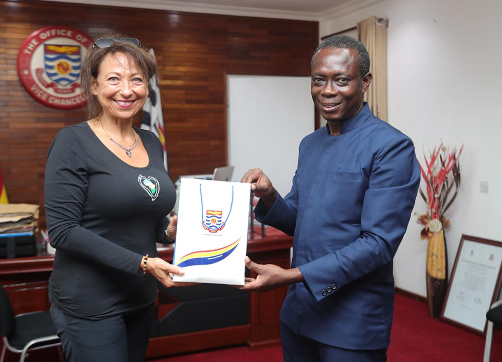 Prof. Boampong presenting a gift to Ms. Rubin